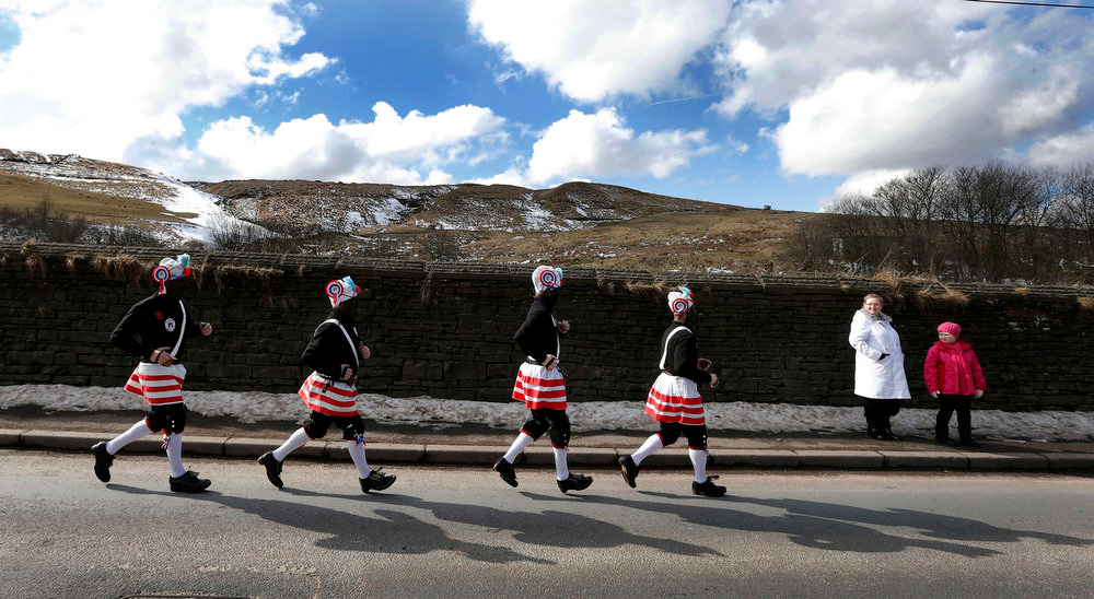 . Members of the Britannia Coconut dancers perform on the roadside near Bacup, northern England, March 30, 2013. The group, which can trace its origins to the mid-1800s, dance along the town\'s roads every Easter Saturday following a tradition to mark out the boundaries of the town.   REUTERS/Phil Noble