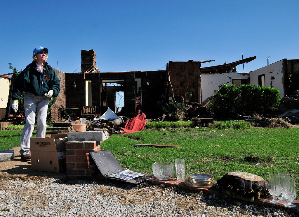 . Bobbie Steenbergen walks outside of what is left of her home that was destroyed by the tornado that swept through Central Oklahoma Friday afternoon on Saturday June 1, 2013 in El Reno Okla. Emergency officials set out Saturday morning to see how much damage a violent burst of thunderstorms and tornadoes caused as it swept across the Midwest overnight.  (AP Photo/Nick Oxford)