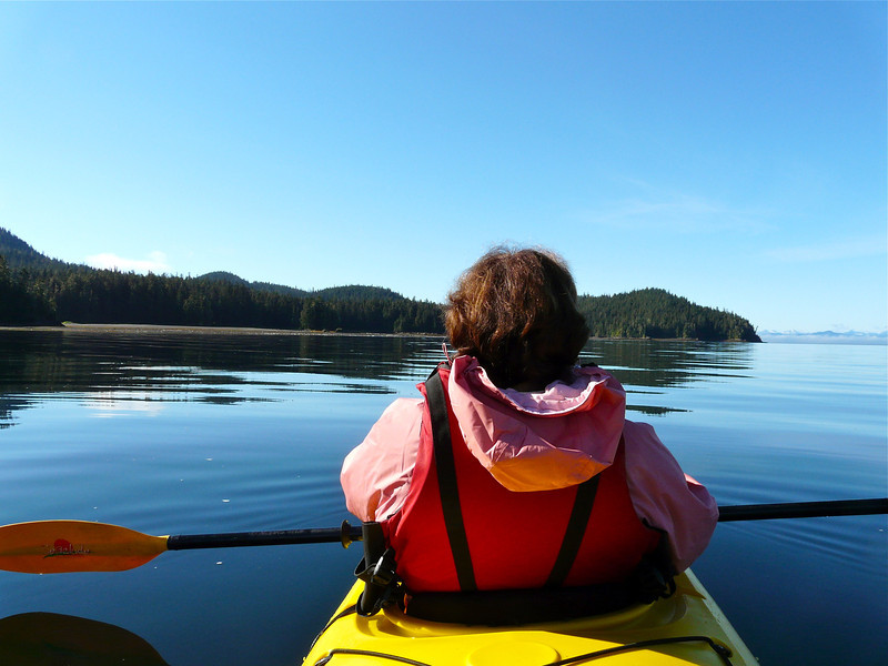 Woman kayaker on the water.