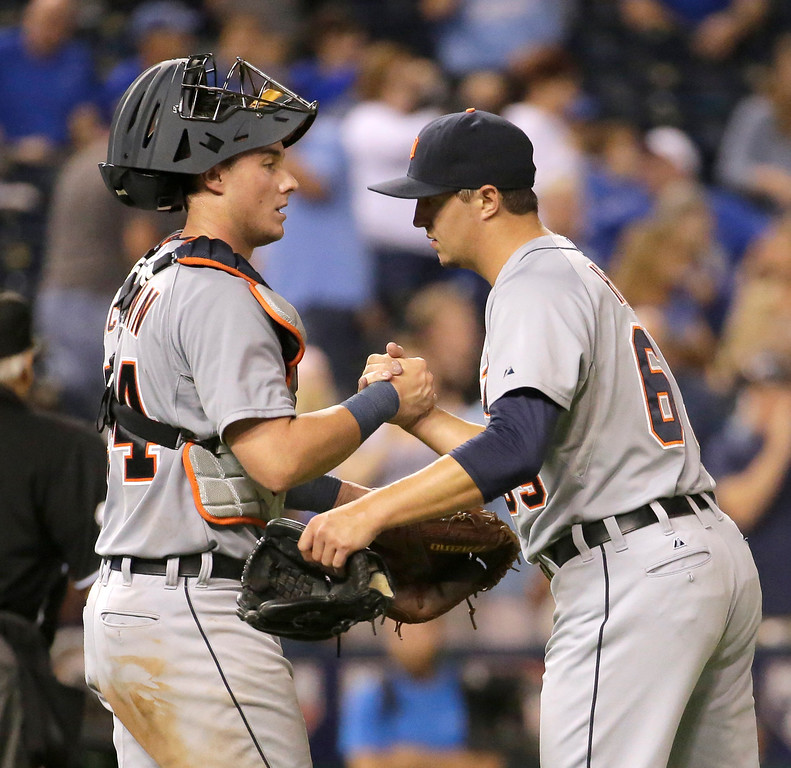 . Detroit Tigers catcher James McCann and relief pitcher Blaine Hardy celebrate after the Tigers\' baseball game against the Kansas City Royals on Friday, Sept. 19, 2014, in Kansas City, Mo. The Tigers won 10-1. (AP Photo/Charlie Riedel)