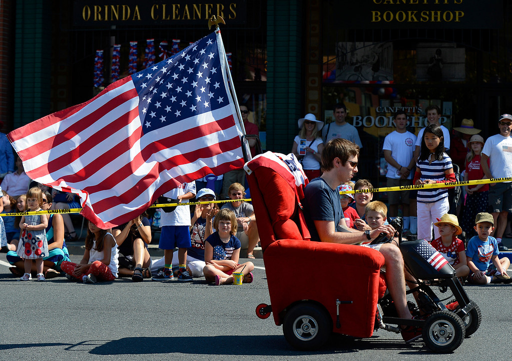 . Chris McIntosh, of Orinda, drives his motorized recliner chair during the 30th anniversary Lamorinda Fourth of July parade and celebration on Thursday, July 4, 2013. The chair, which he got from Craigslist.org, is outfitted with a 125cc motorcycle engine and can reach speeds of 40 m.p.h. (Jose Carlos Fajardo/Bay Area News Group)