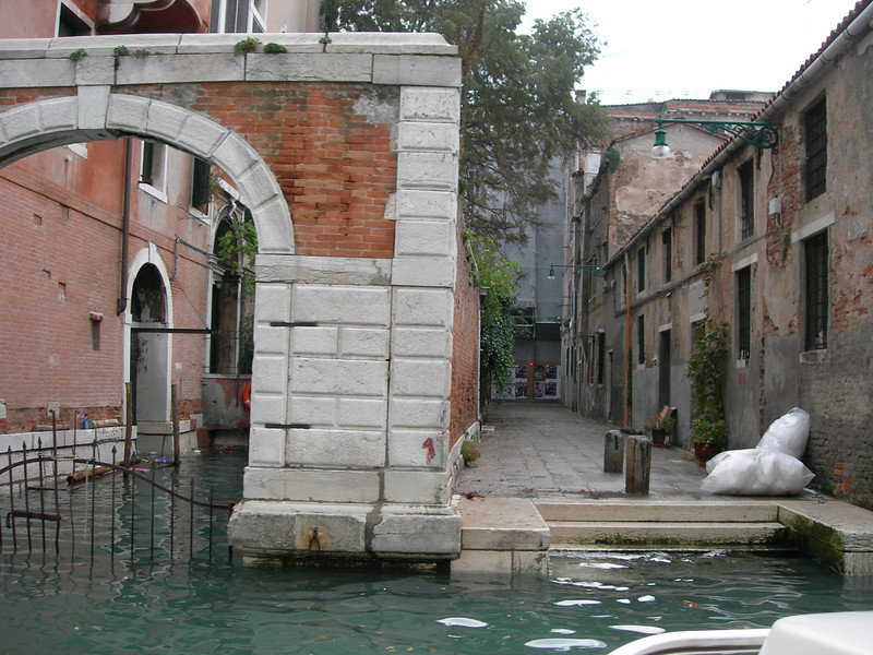 Venice - canal level looking at a stone bridge
