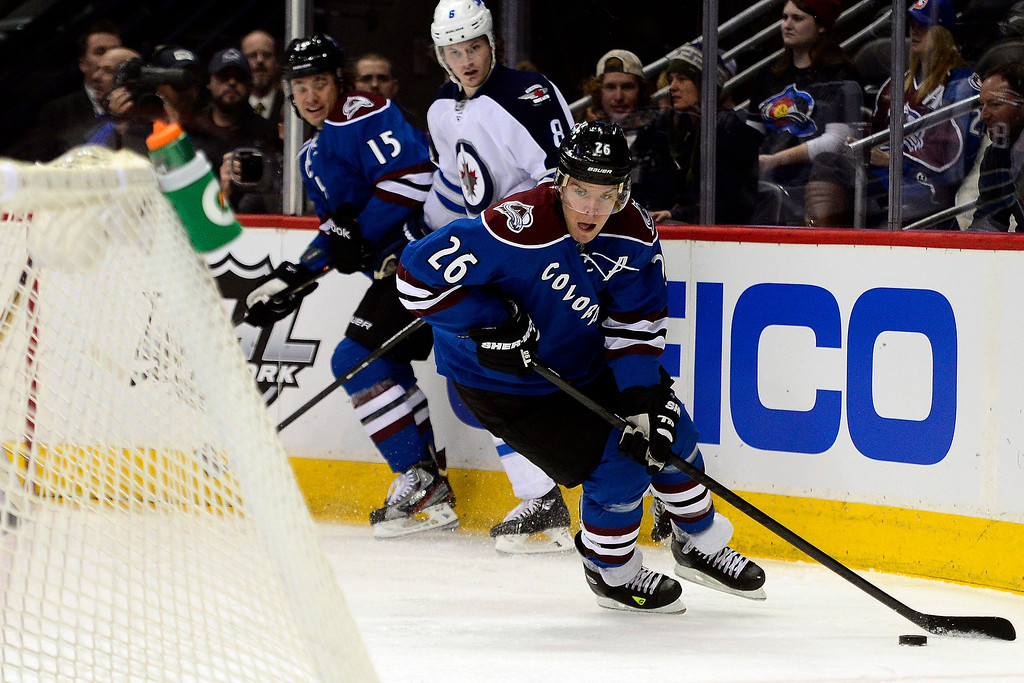 . Paul Stastny (26) of the Colorado Avalanche controls the puck as Jacob Trouba (8) of the Winnipeg Jets defends P.A. Parenteau (15) of the Colorado Avalanche during the first period of action.  (Photo by AAron Ontiveroz/The Denver Post)
