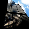 Soaring Willis Tower reflects the clouds on a warm summer's day