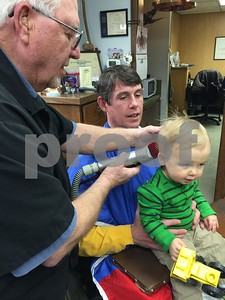 son-gets-1st-haircut-from-family-barber