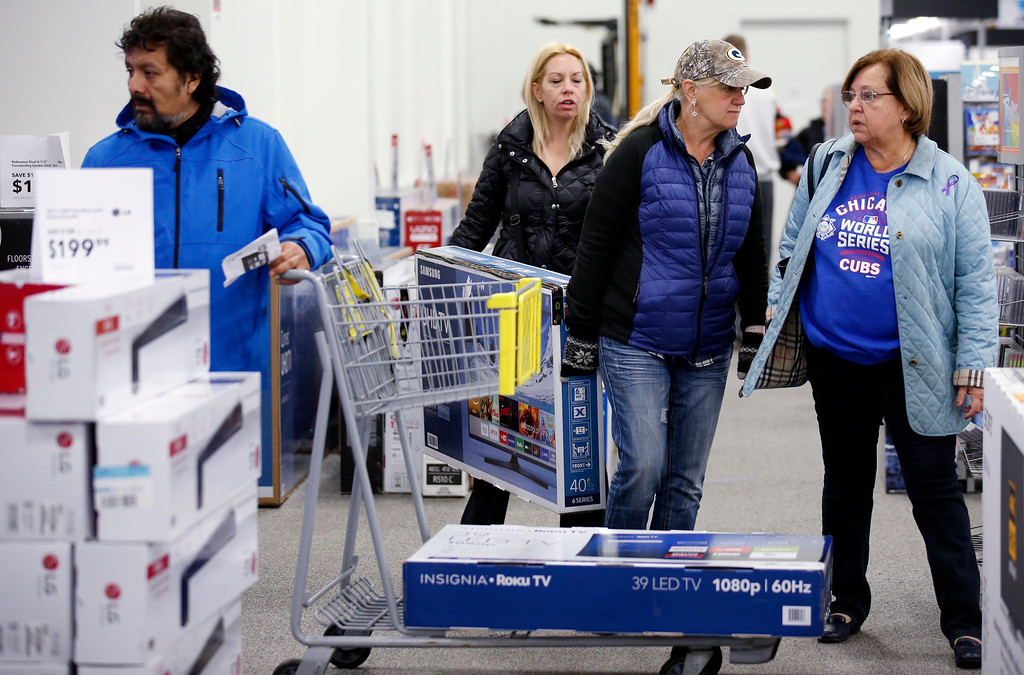 . Shoppers shop at a Best Buy store on Friday, Nov. 25, 2016, in Skokie, Ill. Black Friday, historically the starting line of the retail industry\'s crucial holiday buying season, isn\'t quite the one-day spree it used to be. Some retailers have pushed their biggest Black Friday door-buster deals into Thanksgiving Day and spread other promotions to even earlier in the season. (AP Photo/Nam Y. Huh)