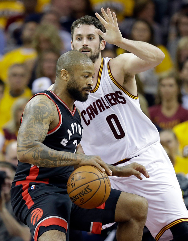 . Toronto Raptors\' P.J. Tucker (2) drives past Cleveland Cavaliers\' Kevin Love (0) in the first half in Game 1 of a second-round NBA basketball playoff series, Monday, May 1, 2017, in Cleveland. The Cavaliers won 116-105. (AP Photo/Tony Dejak)