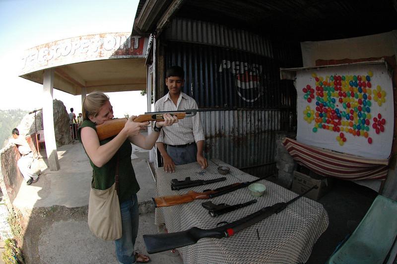 Mussoorie: Cheryl Deutsch shoots balloons with a pellet gun.