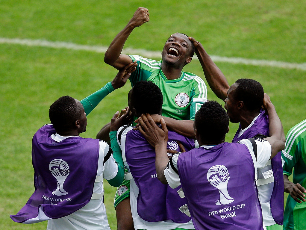 . Nigeria\'s Ahmed Musa, center, celebrates with teammates after scoring his side\'s 2nd goal during the group F World Cup soccer match between Nigeria and Argentina at the Estadio Beira-Rio in Porto Alegre, Brazil, Wednesday, June 25, 2014. (AP Photo/Michael Sohn)