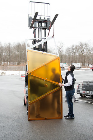 02/15/19 Wesley Bunnell | Staff Sign Pro President Peter Rappoccio stands next to a steel and aluminum trim piece decorated with colored plexiglass which will decorate the Beehive Bridge project. Sign Pro is construction the pieces at its Southington location. Mayor Erin Stewart along with other city employees visited Sign Pro on Friday to gather construction updates.