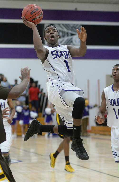 . South senior guard Tyson Purifoy (1) flew to the basket in the first quarter.   Photo By Karl Gehring/The Denver Post