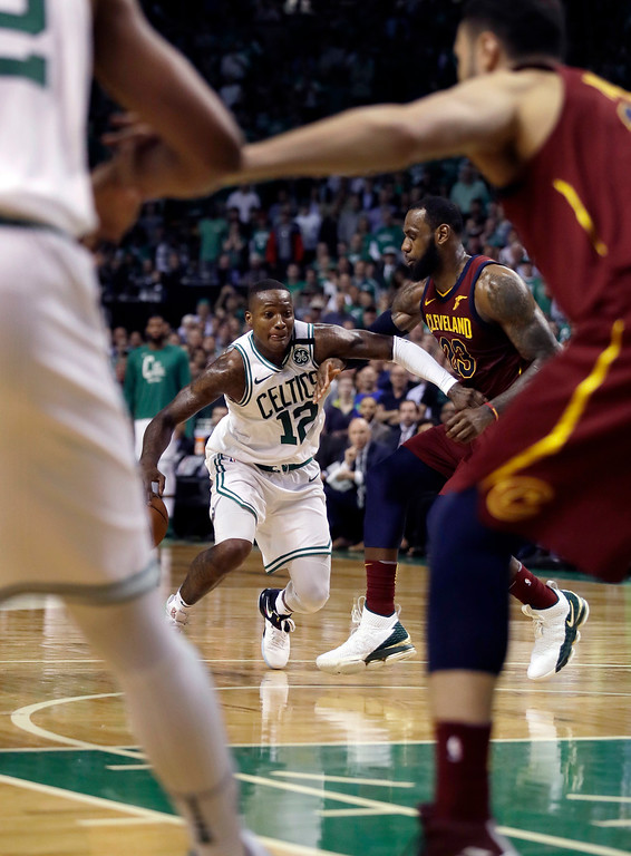 . Boston Celtics guard Terry Rozier (12) fights for position agaisnt Cleveland Cavaliers forward LeBron James (23) during the second half in Game 2 of the NBA basketball Eastern Conference finals, Tuesday, May 15, 2018, in Boston. (AP Photo/Charles Krupa)