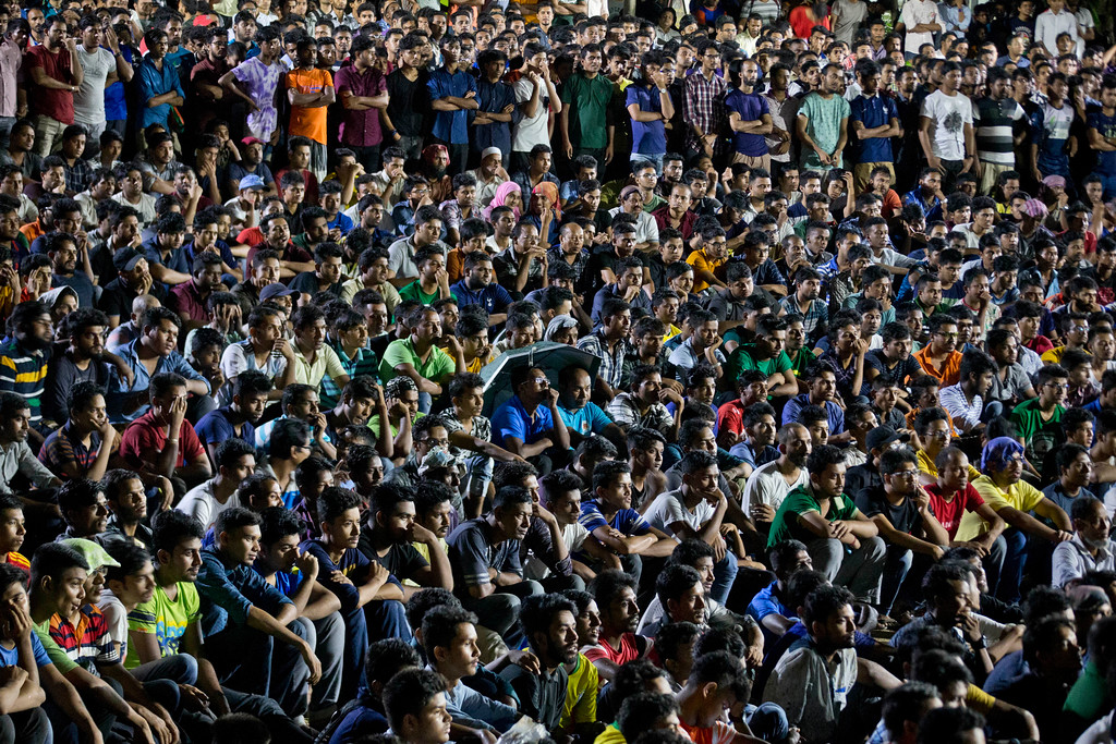 . Bangladeshi people watch the live broadcast of the Soccer World Cup final match between France and Croatia on a screen in Dhaka, Bangladesh, Sunday, July 15, 2018. (AP Photo/A.M. Ahad)