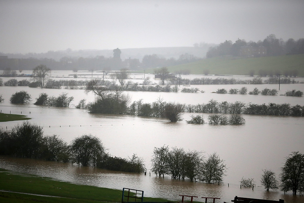 . Fields are flooded near Tewkesbury at the confluence of the River Severn and the River Avon suffers flooding on December 24, 2012 in England. Forecasters have predicted more rain to sweep across the country causing flash flooding over the coming days.  The South West of England has been badly affected causing major disruption to the rail network delaying journeys for people making their way home for Christmas.  (Photo by Christopher Furlong/Getty Images)