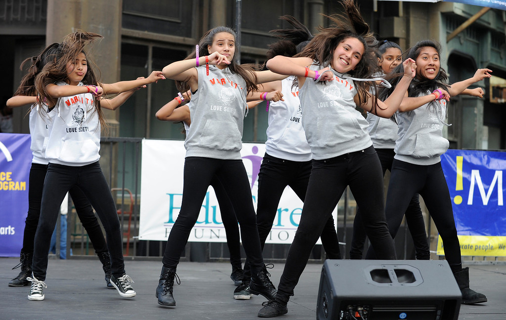 ". Girls from McClay Middle School in Pacoima perform a dance routine.LAUSD\'s program ""Beyond The Bell,\"" held a talent show and competition on the Paramount Studios Lot. Stages were set among streets replicating New York City, where kids from 49 Junior High and High Schools danced, sang, played instruments and gave spoken work performances to compete for more than $40,000 in scholarships. Hollywood , CA 5/11/2013(John McCoy/LA Daily News)"