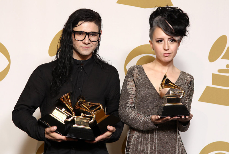 ". Skrillex, left, winner of the awards for best dance/electronica album ""Bangarang,\"" best remixed recording non-classical song for \""Promises\"" and best dance recording \""Bangarang,\"" and Sirah pose backstage with the award for best dance recording \""Bangarang,\"" at the 55th annual Grammy Awards on Sunday, Feb. 10, 2013, in Los Angeles. (Photo by Matt Sayles/Invision/AP)"