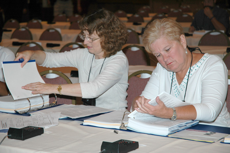 Voting members assemble their notebooks - an ongoing task