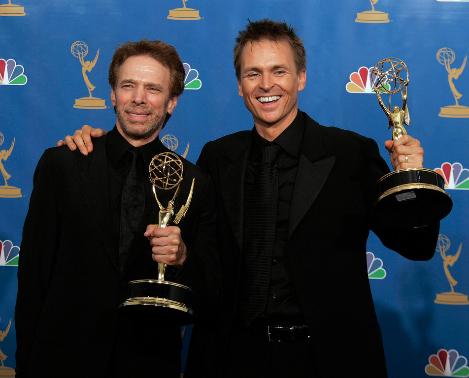 . Producer Jerry Bruckheimer, left. and host Phil Keoghan, right, winners of the Outstanding Reality-Competition Program pose in the press room at the 58th Annual Primetime Emmy Awards at the Shrine Auditorium on August 27, 2006 in Los Angeles. (AP Photo/Reed Saxon)