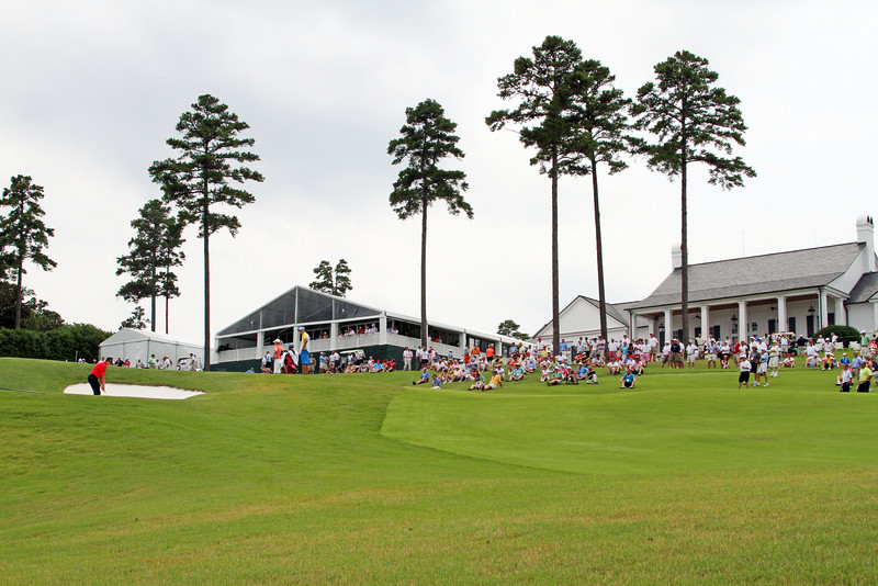 Patrick Rodgers of Avon, IN approaches his bunker shot on the 72nd hole of stroke play while the gallery anxiously awaits during the 2013 Western Amateur at The Alotian Club in Roland, AR. (WGA Photo/Ian Yelton)
