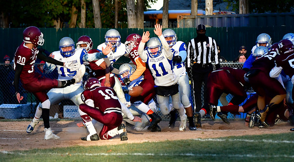 11/23/2018 Mike Orazzi | Staff Bristol Eastern's Justin Marshall (11) blocks an extra point during the Battle for the Bell at Muzzy Field Friday. Central won 24-19.