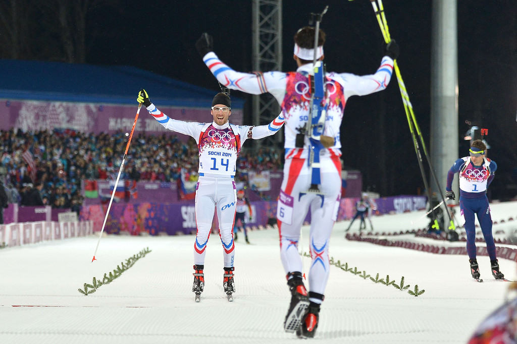 . Bronze medalist France\'s Jean Guillaume Beatrix (L) is congratulated by Gold medalist France\'s Martin Fourcade (C) next to Norway\'s Ole Einar Bjoerndalen (R) at the finish line of competes in the Men\'s Biathlon 12,5 km Pursuit at the Laura Cross-Country Ski and Biathlon Center during the Sochi Winter Olympics on February 10, 2014 in Rosa Khutor near Sochi.  ALBERTO PIZZOLI/AFP/Getty Images