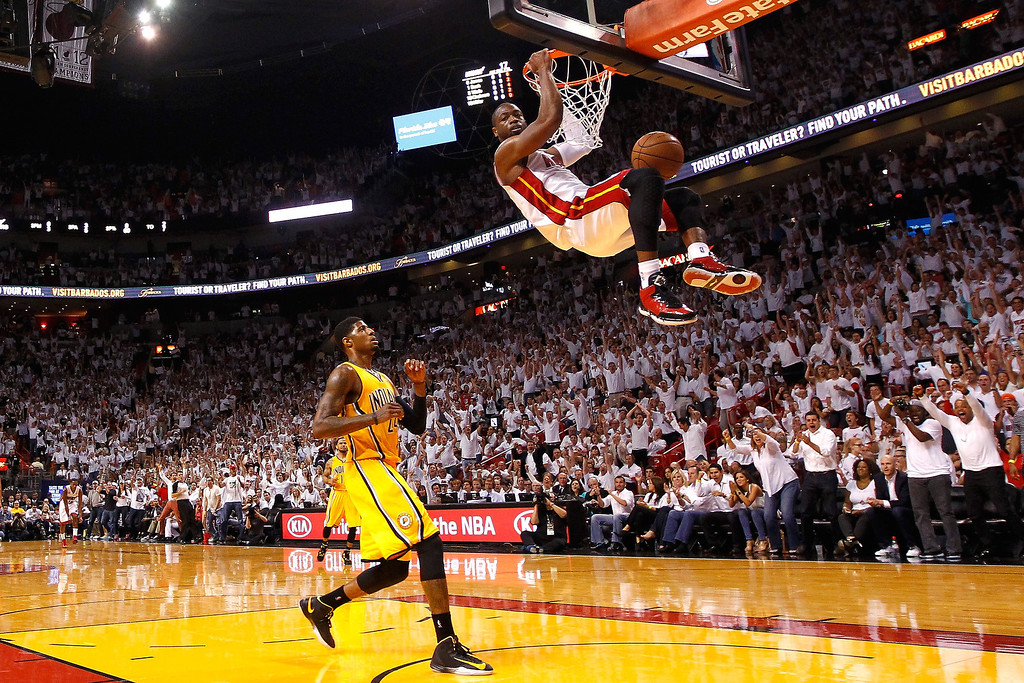 . Dwyane Wade #3 of the Miami Heat dunks in the first half against Paul George #24 of the Indiana Pacers during Game Seven of the Eastern Conference Finals of the 2013 NBA Playoffs at AmericanAirlines Arena on June 3, 2013 in Miami, Florida.   (Photo by Mike Ehrmann/Getty Images)