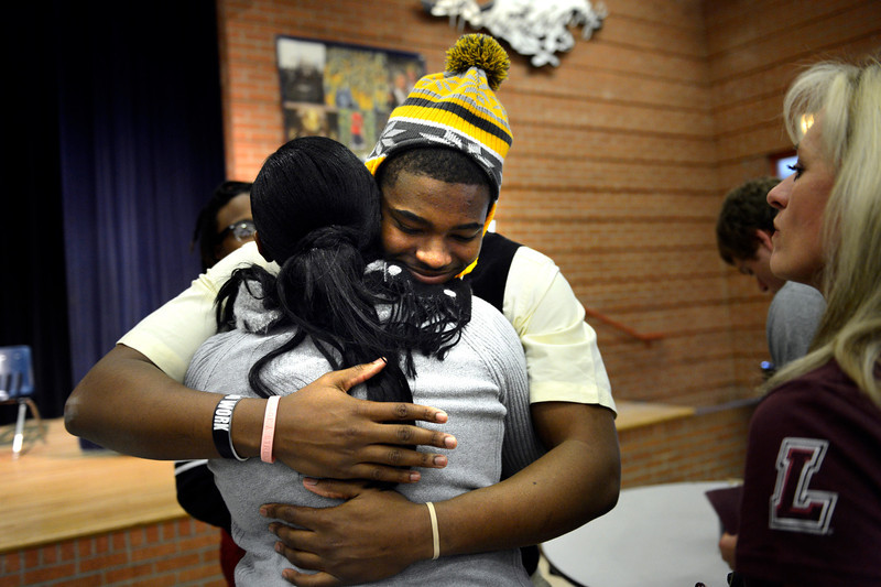 . Cheryl Coleman hugs her son Tim Coleman after he signed his letter of intent to go to Colorado University during college signing day at Mullen High School in the Rilko Event Center on Mullen campus February 6, 2013 Denver, Colorado. (Photo By Joe Amon/The Denver Post)