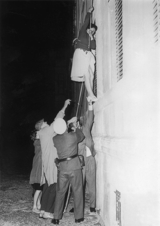 . A woman is lowered from a window in Bernauer Strasse on a rope to escape into the western sector of Berlin after the post-war division of the city, September 10, 1961.  (Photo by Keystone/Getty Images)