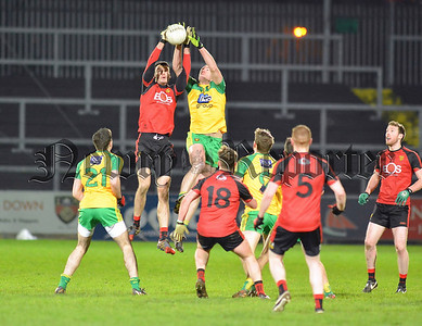 Down debutant Henry Brown battles for possession in mid-air with Donegal substitute Neil Gallagher. RS1605106