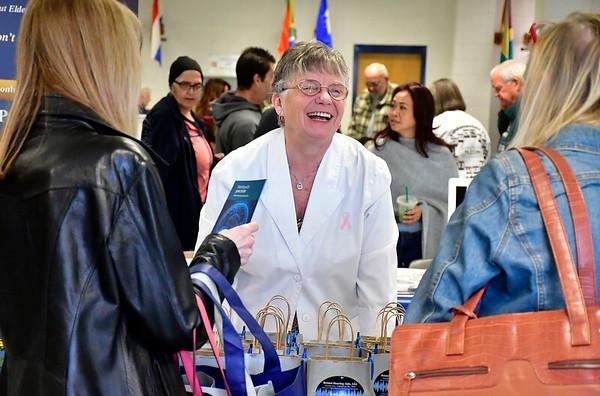 4/6/2019 Mike Orazzi | Staff Bristol Hearing Aids' Joanne Cyr-Callaghan during the 5th Annual Connecticut Prime Time Senior Fair Saturday at Bristol Eastern High School.