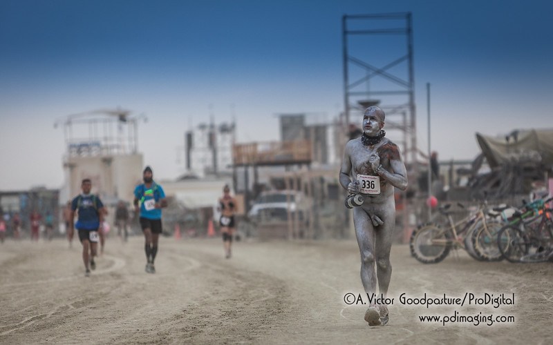Not only is he committng to a lengthy run in the Nevada desert; he's opted to do it painted silver and completely nude. Welcome to Burning Man!