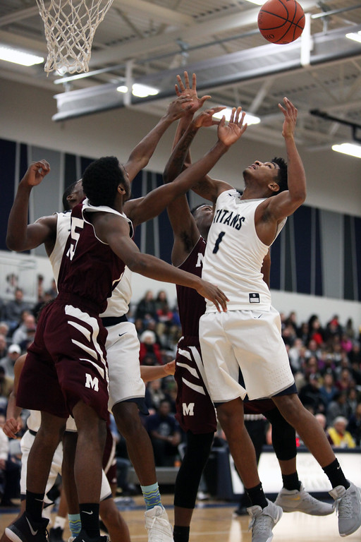 . Randy Meyers -- The Morning Journal Lorain\'s Octavious Wilson and Naz Bohannon battle Deshawn Garner and Kendall McCoy of Maple Heights for a rebound during the second quarter.