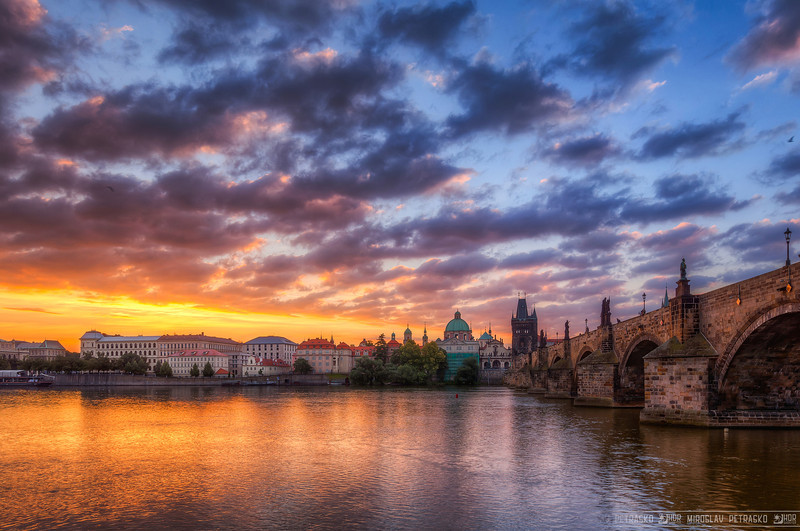 As the sun rises Don't have any new photos, so I'm continuing to edit the photos I took during summer :) I think there are still a lot of them that deserve to be seen. As for instance this one. Taken early morning, right next to the Charles Bridge in Prague. If you ever there, and you want an original shot of the bridge, don't forget to go under it. Not many photographers do and it's worth it :)