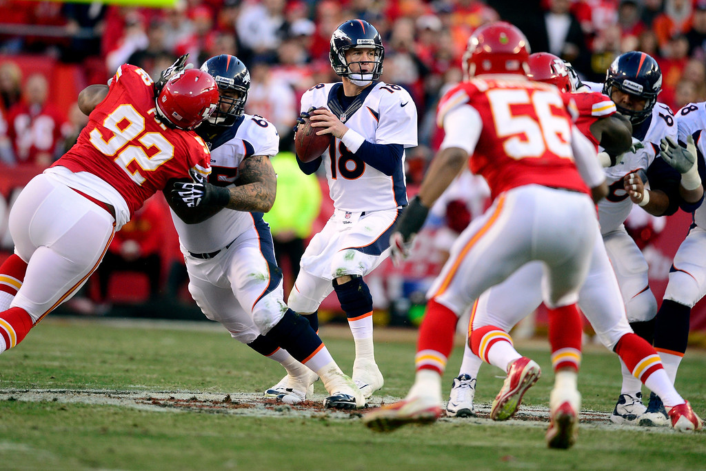 . Peyton Manning (18) of the Denver Broncos works the pocket against the Kansas City Chiefs during the first half of action at Arrowhead Stadium.   (Photo by AAron Ontiveroz/The Denver Post)