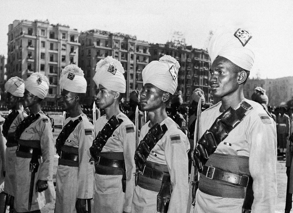 . Egyptian frontier guards stand to attent during a military parade in Cairo\'s Ismail Square on Oct. 23, 1952 in celebration of \'90 days of Freedom.\' The day marked the end of the first three months of major general Mohamed Neguibís rule. In an address, premier Neguib stated that Egypt was prepared to fight for the liberation of the Nile valley. (AP Photo)