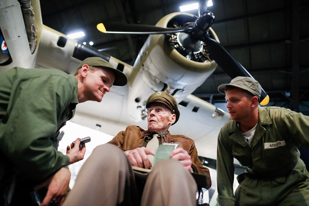 ". United States Air Force (Ret.) Col. Howard Hunt, center, meets with Memphis Belle fans during the private viewing of the Boeing B-17 ""Flying Fortress\"" at the National Museum of the U.S. Air Force, Wednesday, May 16, 2018, in Dayton, Ohio. The World War II bomber Memphis Belle is set to go on display for the first time since getting a yearslong restoration at the museum. The B-17 �Flying Fortress� will be introduced Thursday morning as the anchor of an extensive exhibit in the Dayton-area museum�s World War II gallery. (AP Photo/John Minchillo)"