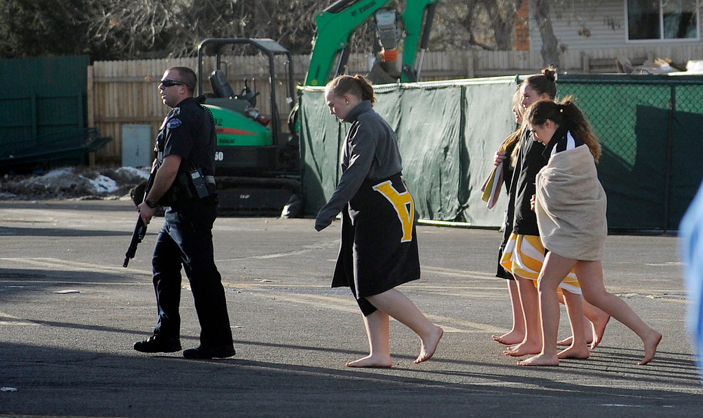 . LITTLETON, CO - DECEMBER 13 : At the school shooting at Arapahoe High School in Littleton, CO  on Friday, December 13, 2013  students  from  a swimming class get an armed escort out of the school.  (Photo By Cyrus McCrimmon/The Denver Post)