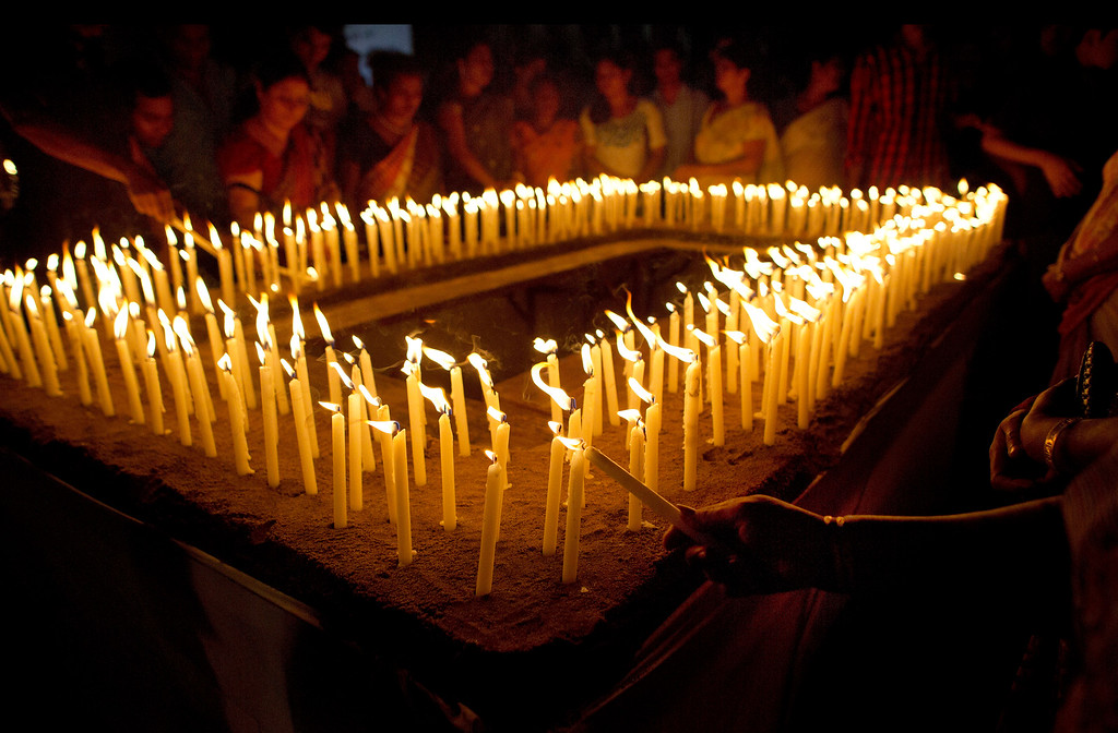 . Indians light candles and offer prayers for victims of Nepalís Saturday earthquake, in Gauhati, India, Thursday, April 30, 2015. The 7.8-magnitude earthquake shook Nepalís capital and the densely populated Kathmandu valley on Saturday devastating the region and leaving tens of thousands shell-shocked and sleeping in streets. (AP Photo/Anupam Nath)