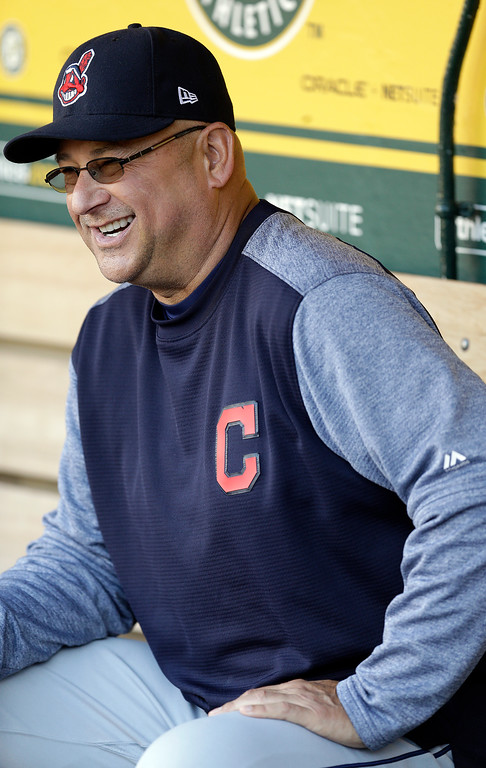 . Cleveland Indians manager Terry Francona laughs in the dugout prior to the team\'s baseball game against the Oakland Athletics on Friday, July 14, 2017, in Oakland, Calif. Francona rejoined his team one week after undergoing a minor procedure for an irregular heartbeat. The 58-year-old Francona was supposed to manage the American League during Tuesday\'s All-Star Game but opted out after undergoing a cardiac ablation procedure at the Cleveland Clinic on July 6. (AP Photo/Ben Margot)