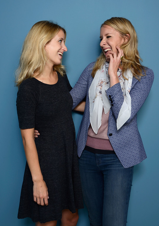 . Prodcuer Grace Hughes-Hallett and director Sarah McCarthy of \'The Dark Matter Of Love\' poses at the Guess Portrait Studio during 2013 Toronto International Film Festival on September 8, 2013 in Toronto, Canada.  (Photo by Larry Busacca/Getty Images)