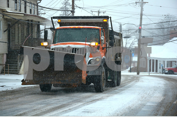 2/7/2018 Mike Orazzi | Staff A Town of Plymouth plow out during Wednesday's storm on Route 6.