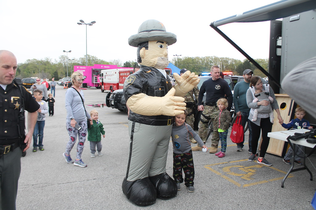. Kristi Garabrandt � The News-Herald <br> Caden Barnard, 5, Mentor hugs the Lake County Sheriff Department\'s mascot during the 36th Annual Heroes Day held at Great Lakes Mall, May 12, 2018.