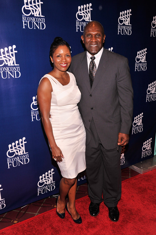 . Former NFL Player Harry Carson (R) and Maribel Carson attend the 28th Annual Great Sports Legends Dinner to Benefit The Buoniconti Fund To Cure Paralysis at The Waldorf Astoria on September 30, 2013 in New York City.  (Photo by Stephen Lovekin/Getty Images for The Buoniconti Fund To Cure Paralysis)