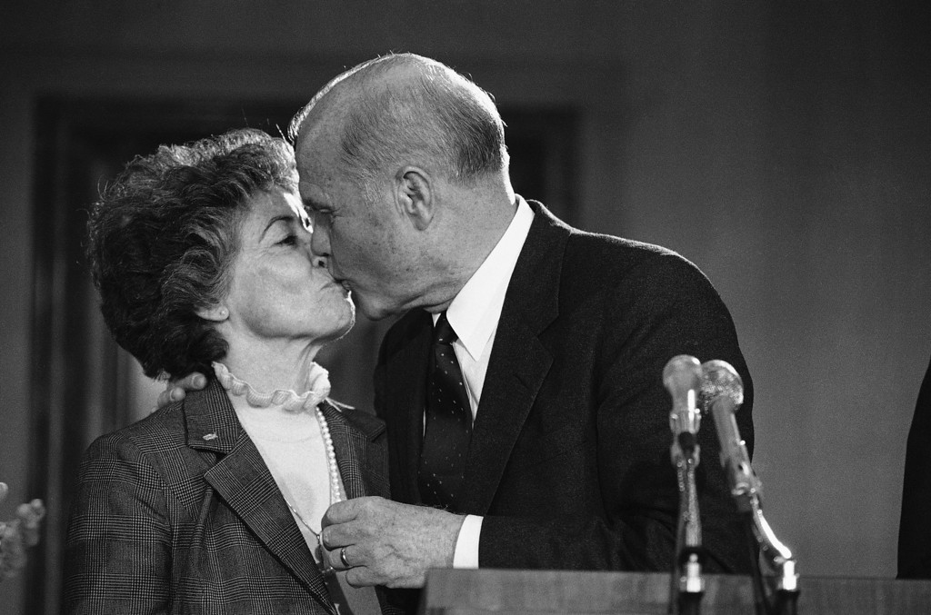 ". Sen. John Glenn kisses his wife Annie shortly after a news conference in Washington, Friday, March 16, 1984. Glenn quit the race for the Democratic presidential nomination Friday after a long campaign that failed to win a single primary or caucus. ""Although my campaign for the presidency will end, my campaign for a better America will continue,\"" Glenn said. (AP Photo/Scott Stewart)"