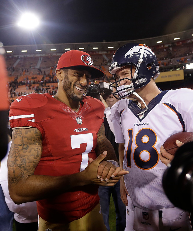 . San Francisco 49ers quarterback Colin Kaepernick, left, greets Denver Broncos quarterback Peyton Manning, right, at the end of their NFL preseason football game Thursday, Aug. 8, 2013, in San Francisco. Denver won the game 10-6. (AP Photo/Marcio Jose Sanchez)
