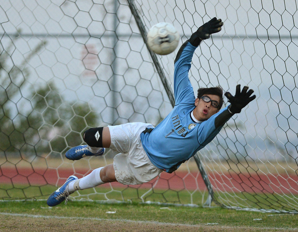 . TS27-ANIMO-CHAD-- Palos Verdes, CALIFORNIA 02/26/13--Staff Photo: Robert Casillas  Animo defeated host Chadwick in Boys soccer Division VI playoff game on penalty kicks (4-2) after overtime game ended 1-1.  Animo GK Celestino Cruz dives at wide PK.