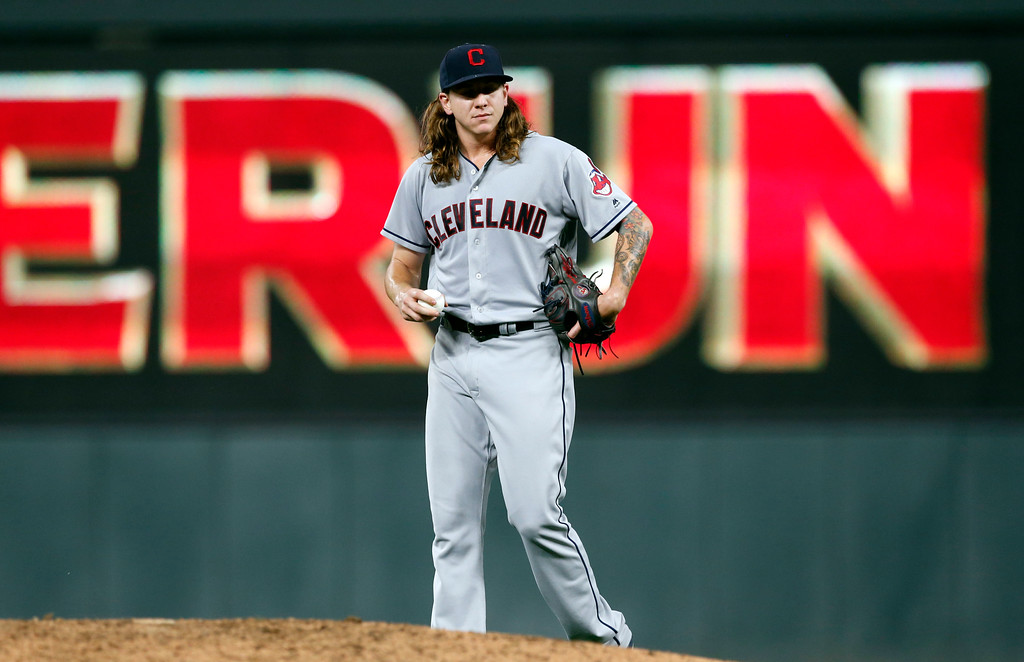 . Cleveland Indians pitcher Mike Clevinger watches as Minnesota Twins\' Max Kepler, rounds the bases on a solo home run during the seventh inning of the second game of a baseball doubleheader Thursday, Aug. 17, 2017, in Minneapolis. The Twins won 4-2. Clevinger took the loss. (AP Photo/Jim Mone)
