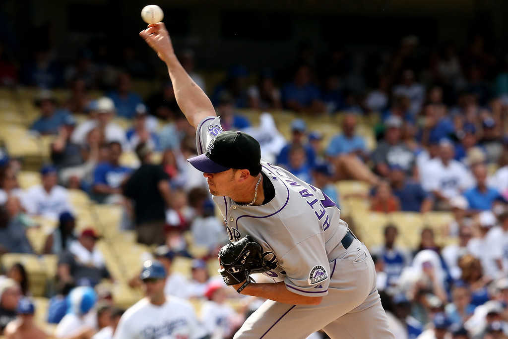 . Closer Rafael Betancourt #63 of the Colorado Rockies throws a pitch in the ninth inniing on his way to picking up the save against the Los Angeles Dodgers at Dodger Stadium on July 14, 2013 in Los Angeles, California.  The Rockies won 3-1.  (Photo by Stephen Dunn/Getty Images)