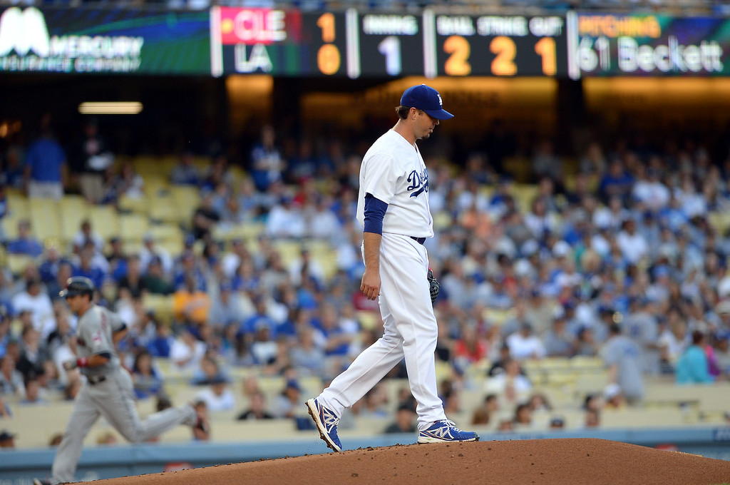 . Los Angeles Dodgers pitcher Josh Beckett circles the mound after giving up a 2-run homerun against the Cleveland Indians July 1, 2014 in Los Angeles.(Andy Holzman/Los Angeles Daily News)
