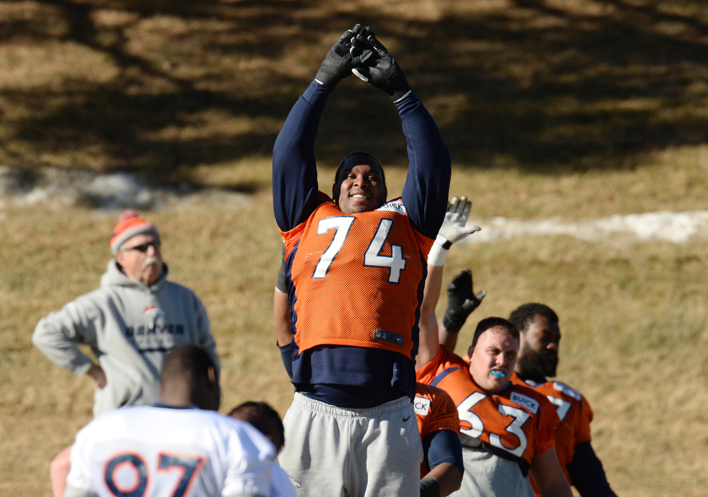 . Denver Broncos Orlando Franklin (74) is warming up for the team practice at Dove Valley. Centennial Colorado. January 17. 2014. (Photo by Hyoung Chang/The Denver Post)